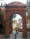 Four Per Cent Industrial Dwellings Company commemorative arch dated 1886, Wentworth Street